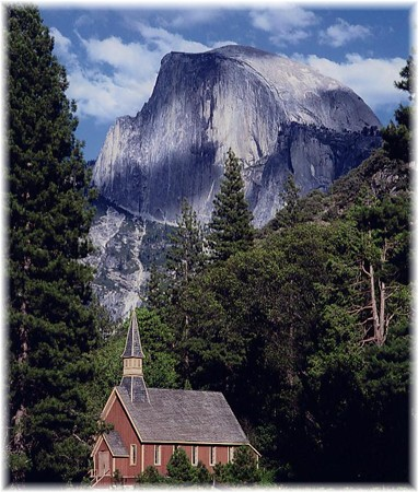 Photo of the Yosemite Valley Chapel with Half Dome behind it            (Dan Warsinger Photography)